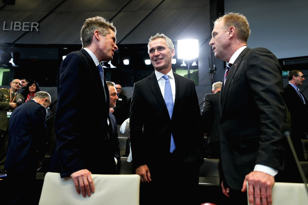 BRUSSELS, Feb. 14, 2019 - NATO Secretary General Jens Stoltenberg (C) talks to acting U.S. Secretary of Defense Patrick Shanahan (R) and British Secretary of State for Defence Gavin Williamson before ...