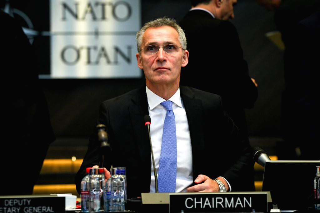 BRUSSELS, Feb. 14, 2019 - NATO Secretary General Jens Stoltenberg raises the hammer to open the NATO defense ministers meeting at the NATO headquarters in Brussels, Belgium, Feb. 14, 2019.