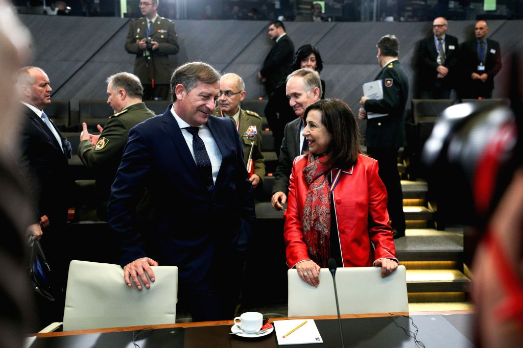 BRUSSELS, Feb. 14, 2019 - Spanish Defense Minister Margarita Robles (R, front) talks to Slovenian Defense Minister Karl Erjavec before the NATO defense ministers meeting at the NATO headquarters in ... - Margarita Robles