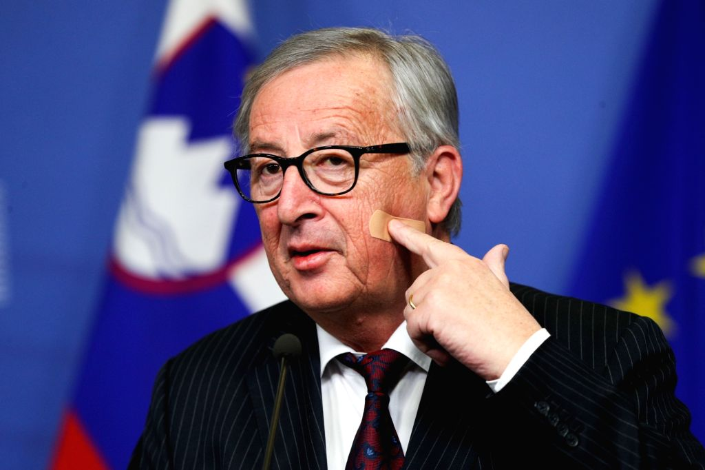 BRUSSELS, Feb. 20, 2019 - European Commission President Jean-Claude Juncker points to a Band-Aid on his face during a press conference at the EU headquarters in Brussels, Belgium, on Feb. 20, 2019.