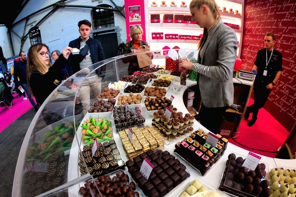 BRUSSELS, Feb. 22, 2019 - Visitors select chocolates at the 6th edition of the Chocolate Fair in Brussels, Belgium, on Feb. 22, 2019. The 6th edition of the Chocolate Fair (Le Salon du Chocolat) ...