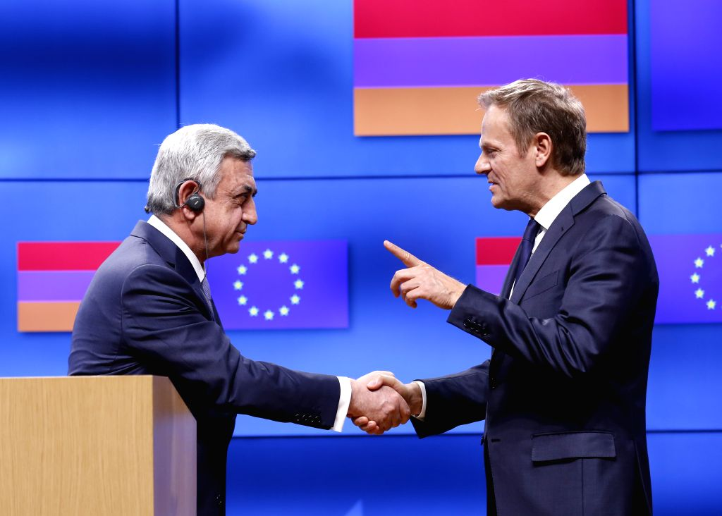 BRUSSELS, Feb. 27, 2017 - European Council President Donald Tusk (R) shakes hands with visiting Armenian President Serzh Sargsyan after a joint press statement at EU headquarters in Brussels, ...