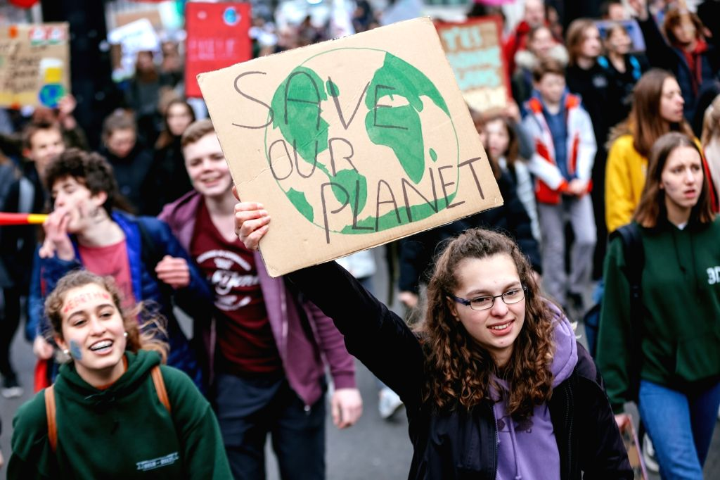 BRUSSELS, Feb. 28, 2019 - Students hold placards as they attend a climate march in Brussels, Belgium, on Feb. 28, 2019. A new climate march by schoolchildren and college students was organized across ...