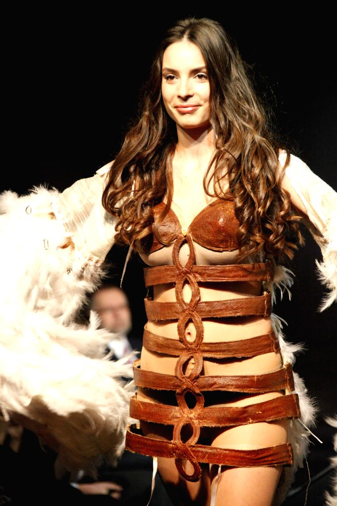 A model presents a creation during a chocolate fashion show in the VIP evening of the Chocolate Salon in Brussels, capital of Belgium, Feb. 5, 2015. The second, ...