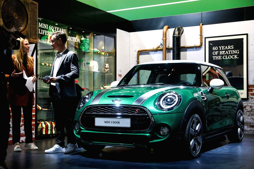 BRUSSELS, Jan. 18, 2019 - Two journalists talk about the Mini Cooper 60 Year Anniversary Edition car during its world premiere at the 97th Brussels Motor Show in the Brussels Expo in Brussels, ...