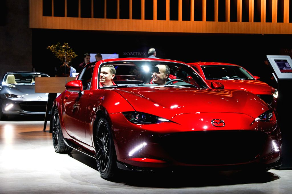 BRUSSELS, Jan. 18, 2019 - Visitors experience a Mazda MX-5 car at the 97th Brussels Motor Show in the Brussels Expo in Brussels, Belgium, Jan. 18, 2019. The 97th Brussels Motor Show will be open to ...