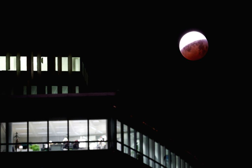 """BRUSSELS, Jan. 21, 2019 - The moon is seen during a total lunar eclipse, known as the """"Super Blood Wolf Moon"""", in Brussels, Belgium Jan. 21, 2019."""