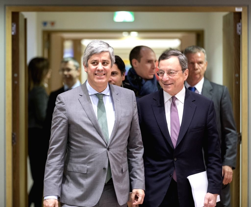 BRUSSELS, Jan. 22, 2018 - Eurogroup President and Portuguese Finance Minister Mario Centeno (L, front) and European Central Bank (ECB) President Mario Draghi (R, front) arrive for an Eurogroup ... - Mario Centeno