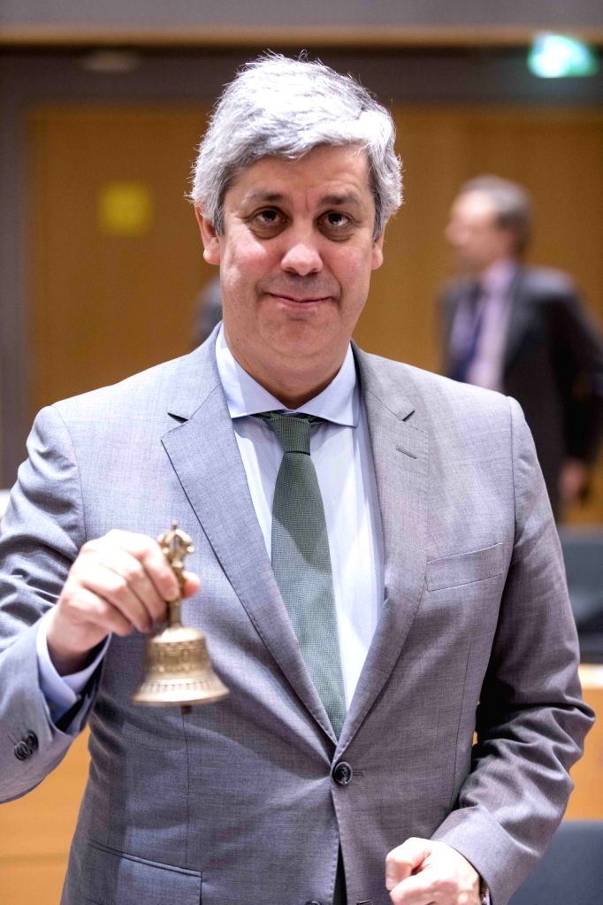 BRUSSELS, Jan. 22, 2018 - Eurogroup President and Portuguese Finance Minister Mario Centeno rings a bell as he chairs his first Eurogroup finance ministers meeting at the EU Council in Brussels, ... - Mario Centeno