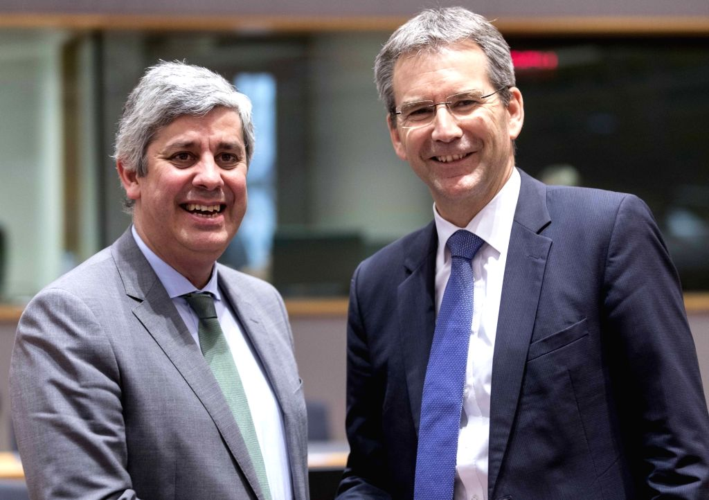 BRUSSELS, Jan. 22, 2018 - Eurogroup President and Portuguese Finance Minister Mario Centeno (L) and Austrian Finance Minister Hartwig Loeger pose for photos prior to an Eurogroup finance ministers ... - Mario Centeno