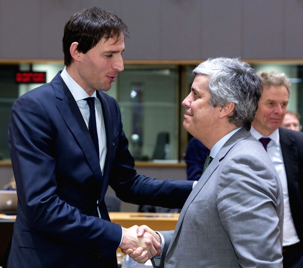BRUSSELS, Jan. 22, 2018 - Eurogroup President and Portuguese Finance Minister Mario Centeno (R) shakes hands with Dutch Finance Minister Wopke Hoekstra prior to an Eurogroup finance ministers meeting ... - Mario Centeno