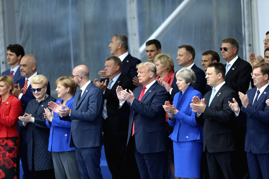 BRUSSELS, July 11, 2018 - ers observe a helicopter flypast during a NATO summit in Brussels, Belgium, July 11, 2018. NATO leaders gather in Brussels for a two-day meeting.