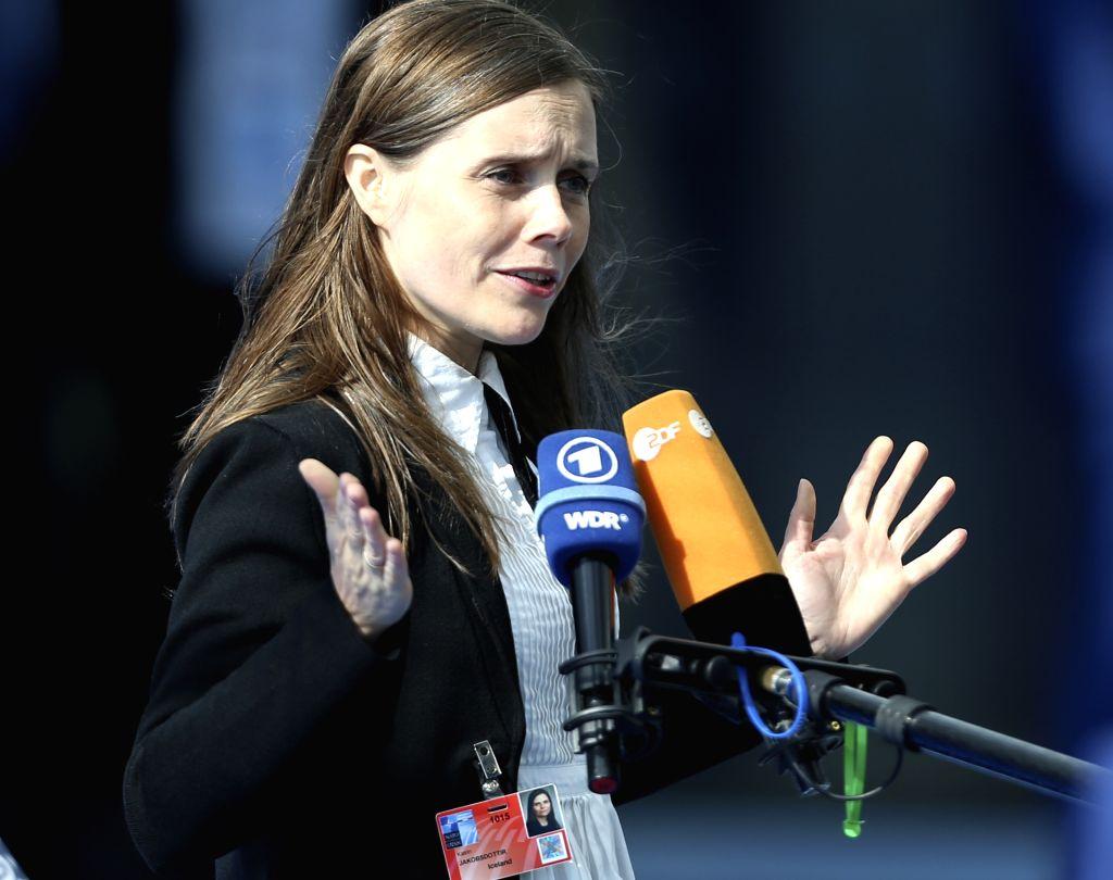 BRUSSELS, July 11, 2018 - Iceland's Prime Minister Katrin Jakobsdottir speaks to media as she arrives at a NATO summit in Brussels, Belgium, July 11, 2018. NATO leaders gather in Brussels for a ... - Katrin Jakobsdottir