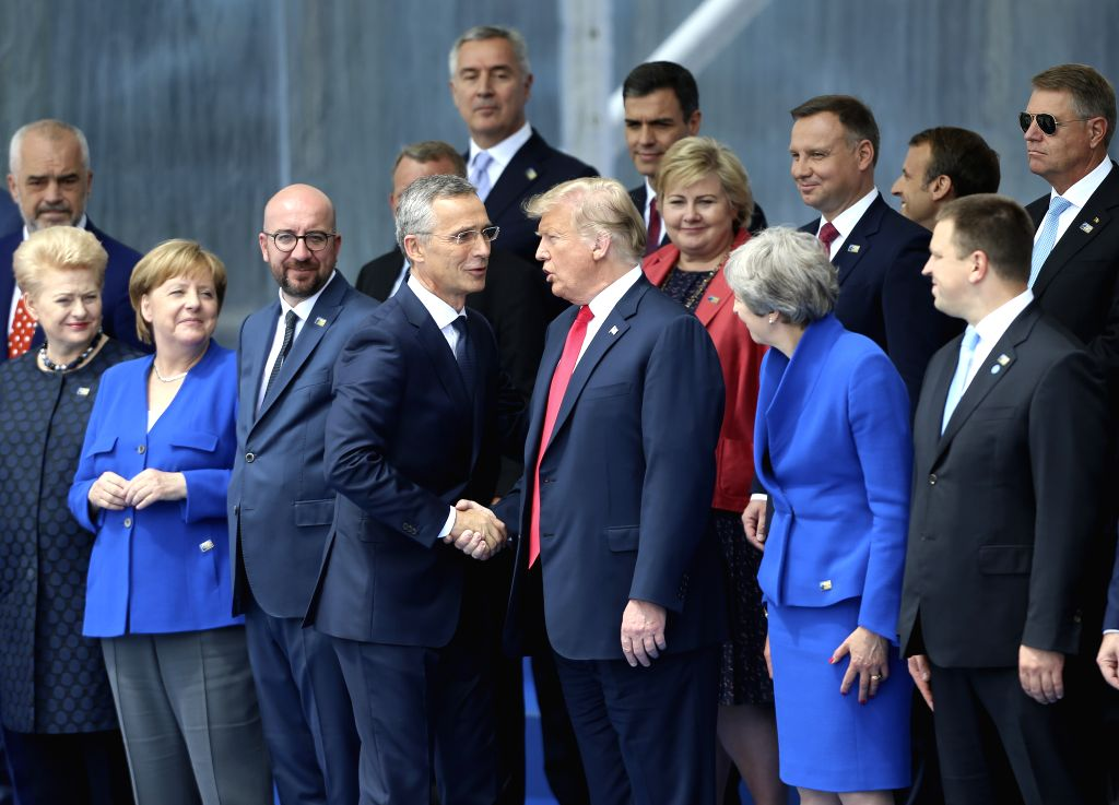 BRUSSELS, July 11, 2018 - NATO Secretary General Jens Stoltenberg (center L) shakes hands with U.S. President Donald Trump during a NATO summit in Brussels, Belgium, July 11, 2018. NATO leaders ...