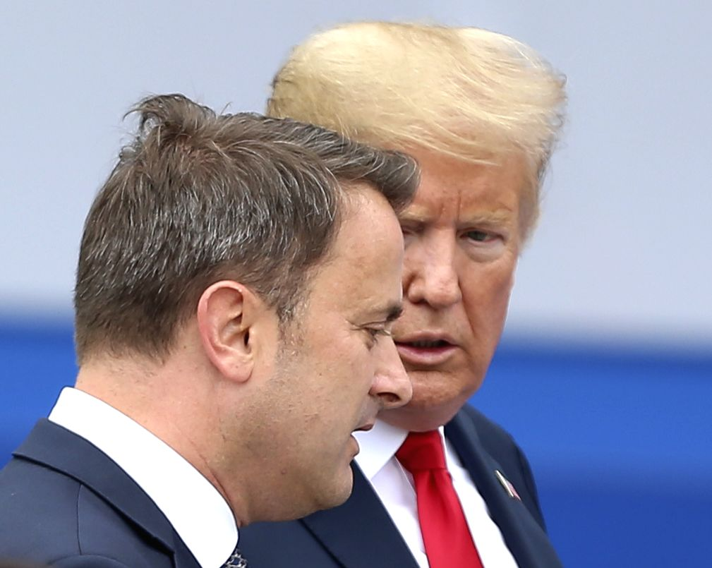 BRUSSELS, July 11, 2018 - U.S. President Donald Trump (back) speaks with Luxembourg Prime Minister Xavier Bettel during a NATO summit in Brussels, Belgium, July 11, 2018. NATO leaders gather in ... - Xavier Bettel