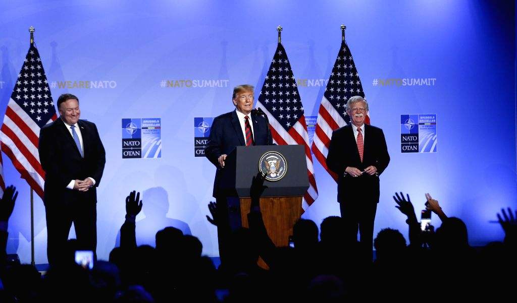 BRUSSELS, July 12, 2018 - U.S. President Donald Trump (C), U.S. Secretary of State Mike Pompeo (L) and U.S. National Security Advisor John Bolton (R) attend a press conference on the second day of ...