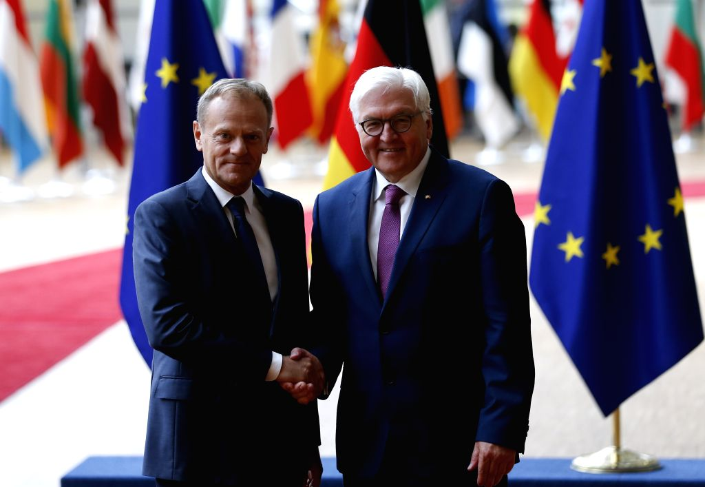 BRUSSELS, June 16, 2017 - The European Council President Donald Tusk (L) shakes hands with visiting German President Frank-Walter Steinmeier at EU Council headquarters in Brussels, Belgium, June 16, ...