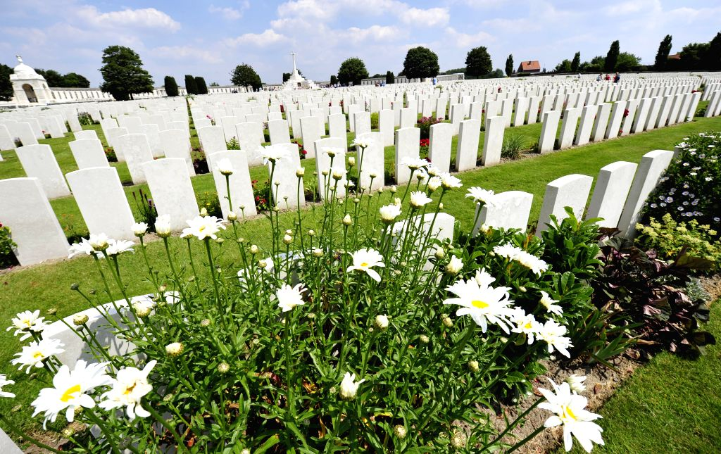 Photo taken on June 26, 2014 shows tombstones of the Tyne Cot Cemetery, the biggest cemetery for the dead soldiers of the World War I in Belgium, in Ypres, ...