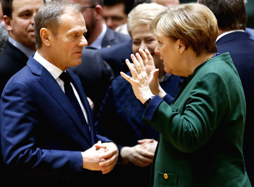 BRUSSELS, March 10, 2017 - European Council President Donald Tusk (front, L) talks with German Chancellor Angela Merkel (front, R) during a meeting on the second day of the European spring summit in ...