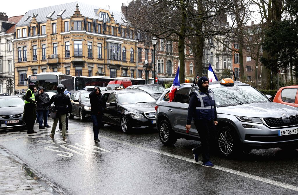 BRUSSELS, March 27, 2018 - Taxi cars park on road blocking the traffic in downtown Brussels, Belgium, March 27, 2018. Taxi drivers held a protest here on Tuesday against Uber.