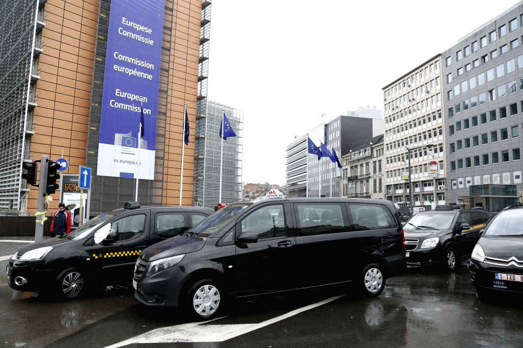 BRUSSELS, March 27, 2018 - Taxi cars park on road in front of EU headquarters in downtown Brussels, Belgium, March 27, 2018. Taxi drivers held a protest here on Tuesday against Uber.