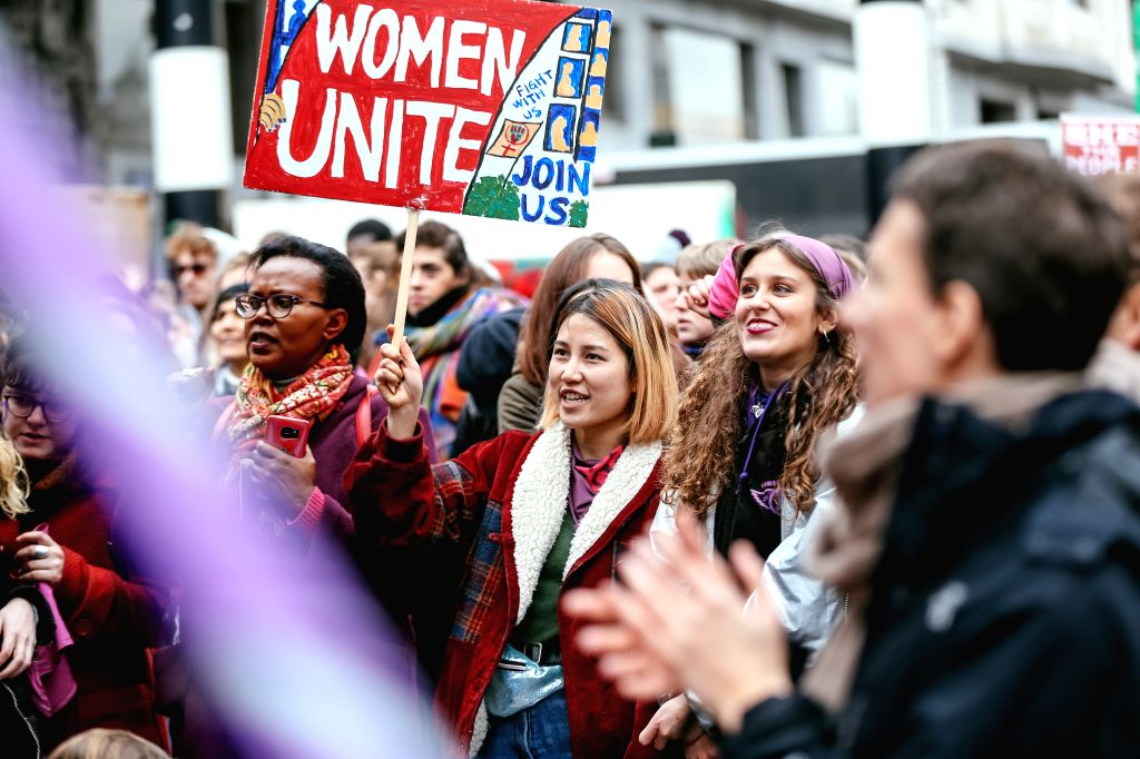 BRUSSELS, March 8, 2019 - People take part in a women's strike in Brussels, Belgium, March 8, 2019. Thousands of women went on strike across Belgium on International Women's Day to campaign for ...