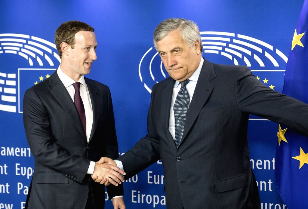 BRUSSELS, May 22, 2018 - Founder and CEO of Facebook Mark Zuckerberg (L) shakes hands with European Parliament President Antonio Tajani ahead of a meeting at the European Parliament in Brussels, ...