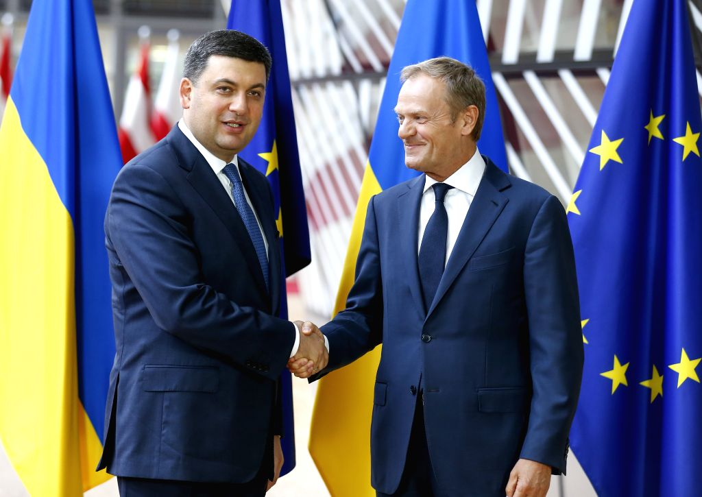 BRUSSELS, May 24, 2018 - European Council President Donald Tusk (R) shakes hands with visiting Ukrainian Prime Minister Volodymyr Groysman in Brussels, Belgium, May 24, 2018. Ukrainian Prime Minister ... - Volodymyr Groysman