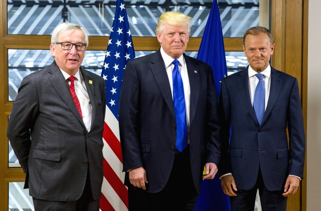 BRUSSELS, May 25, 2017 - U.S. President Donald Trump (C) poses for photos with European Commission President Jean-Claude Juncker (1st L) and European Council President Donald Tusk at the European ...