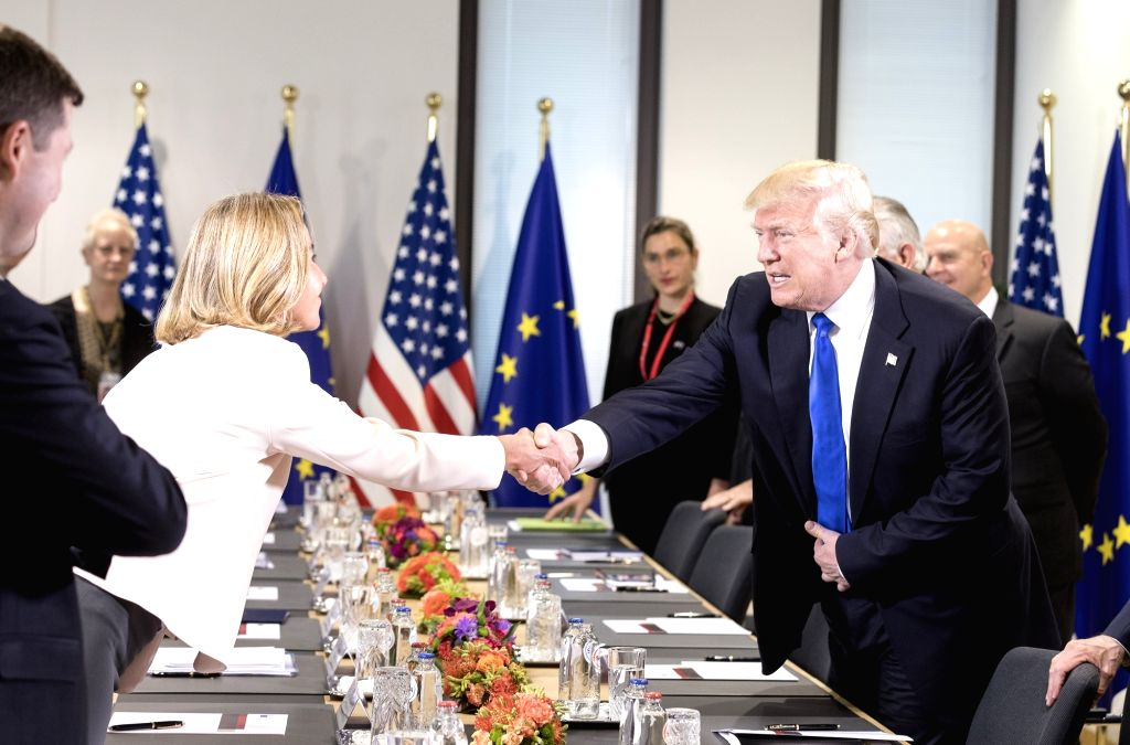 BRUSSELS, May 25, 2017 - U.S. President Donald Trump (R) shakes hands with Federica Mogherini, the EU's High Representative for Foreign Affairs and Security Policy, during the EU-USA ers' Meeting ...