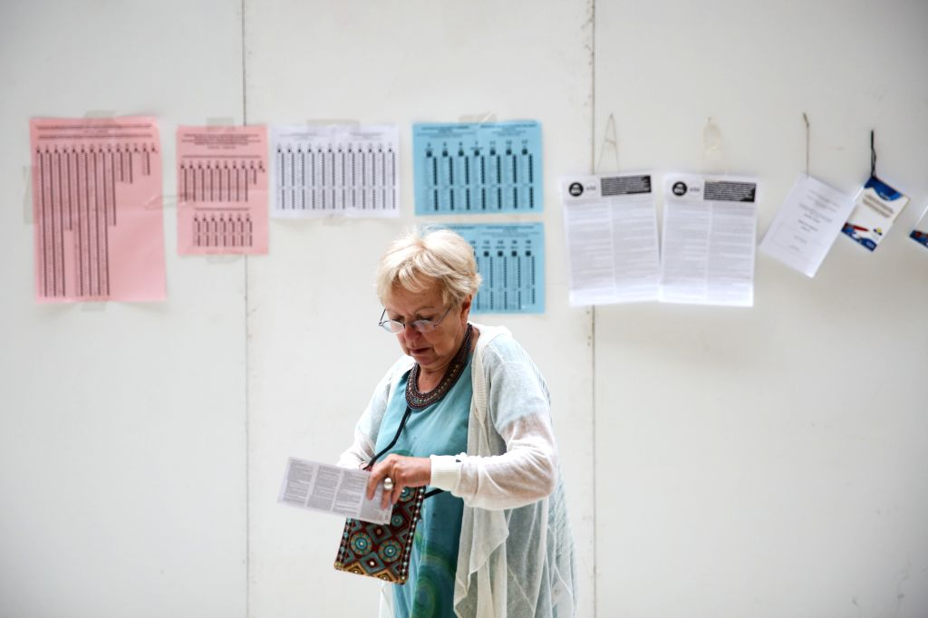 BRUSSELS, May 26, 2019 - A woman leaves after casting her vote at a polling station in Brussels, Belgium, May 26, 2019. The European Parliament (EU) elections started in Belgium on Sunday.
