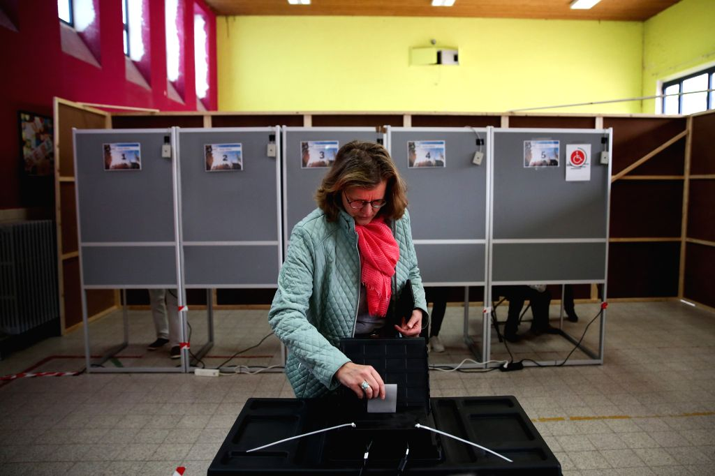 BRUSSELS, May 26, 2019 - A woman votes at a polling station in Brussels, Belgium, May 26, 2019. The European Parliament (EU) elections started in Belgium on Sunday.