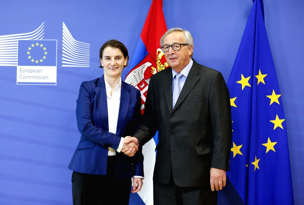 BRUSSELS, Oct. 11, 2017 - Serbian Prime Minister Ana Brnabic (L) meets with European Commission President Jean-Claude Juncker at EU headquarters in Brussels, Belgium, Oct. 11, 2017. - Ana Brnabic