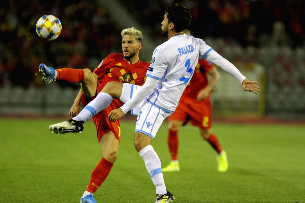 BRUSSELS, Oct. 11, 2019 - Dries Mertens (L) of Belgium competes with San Marino's Mirko Palazzi during the UEFA Euro 2020 qualifying round Group I match between Belgium and San Marino in Brussels, ...