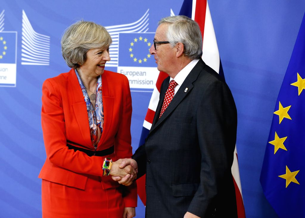 BRUSSELS, Oct. 21, 2016 - European Commission President Jean-Claude Juncker (R) shakes hands with British Prime Minister Theresa May during their meeting in Brussels, Belgium, Oct. 21, 2016. - Theresa May