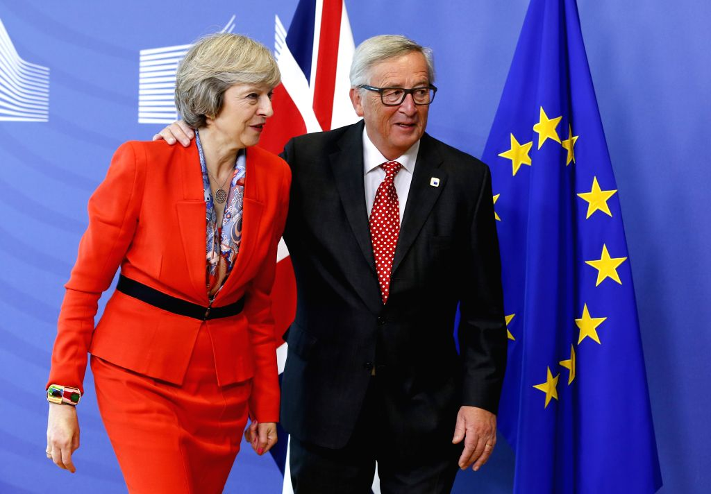 BRUSSELS, Oct. 21, 2016 - European Commission President Jean-Claude Juncker (R) meets with British Prime Minister Theresa May in Brussels, Belgium, Oct. 21, 2016. - Theresa May