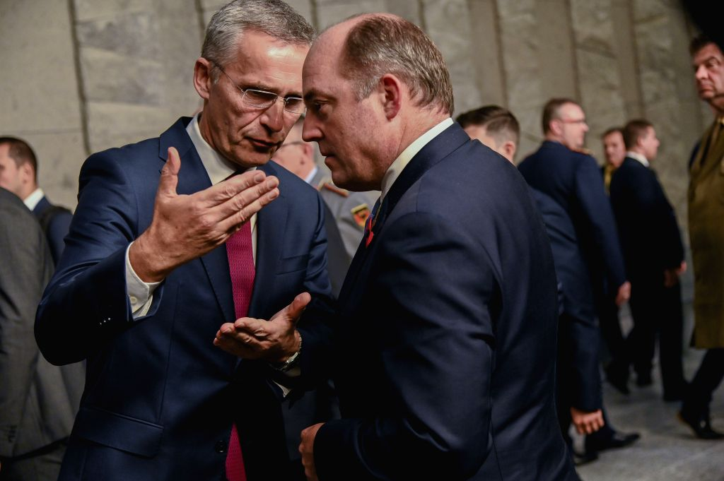BRUSSELS, Oct. 24, 2019 - NATO Secretary General Jens Stoltenberg (L, Front) speaks with UK Defense Secretary Ben Wallace (R, Front) at the official portrait of meetings of NATO ministers of defense ...