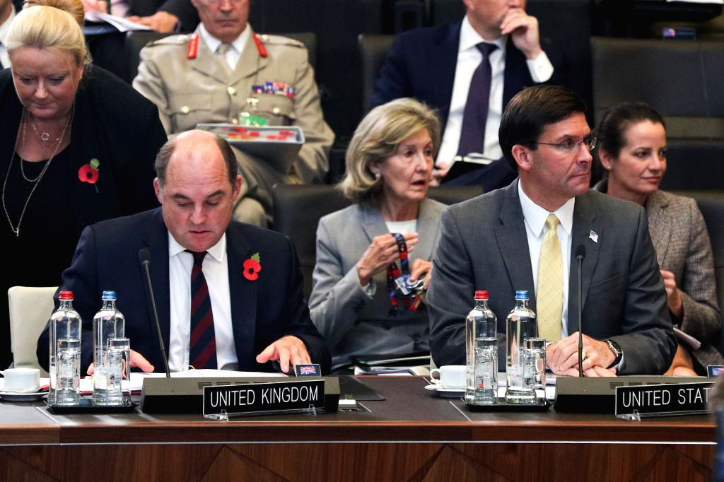 BRUSSELS, Oct. 25, 2019 - U.S. Secretary of Defense Mark Esper (R, front) and British Defense Secretary Ben Wallace (L, front) attend the meeting of the North Atlantic Council in Defence Ministers' ...