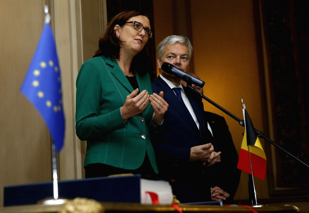 BRUSSELS, Oct. 29, 2016 - EU Commissioner of Trade Cecilia Malmstrom (L) speaks to media as Belgian Deputy Prime Minister and Minister of Foreign Affairs Didier Reynders stands next to her after a ...
