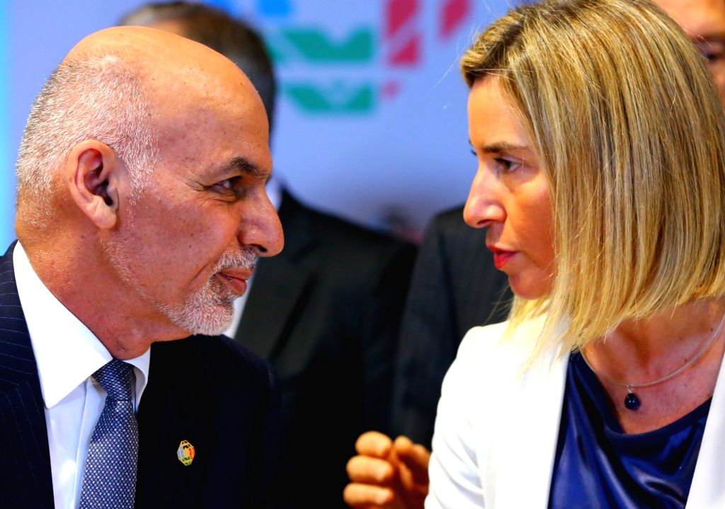 BRUSSELS, Oct. 5, 2016 - Afghan President Ashraf Ghani Ahmadza (L) speaks with EU foreign policy chief Federica Mogherini during the Brussels Conference on Afghanistan in Brussels, Belgium, Oct. 5, ...