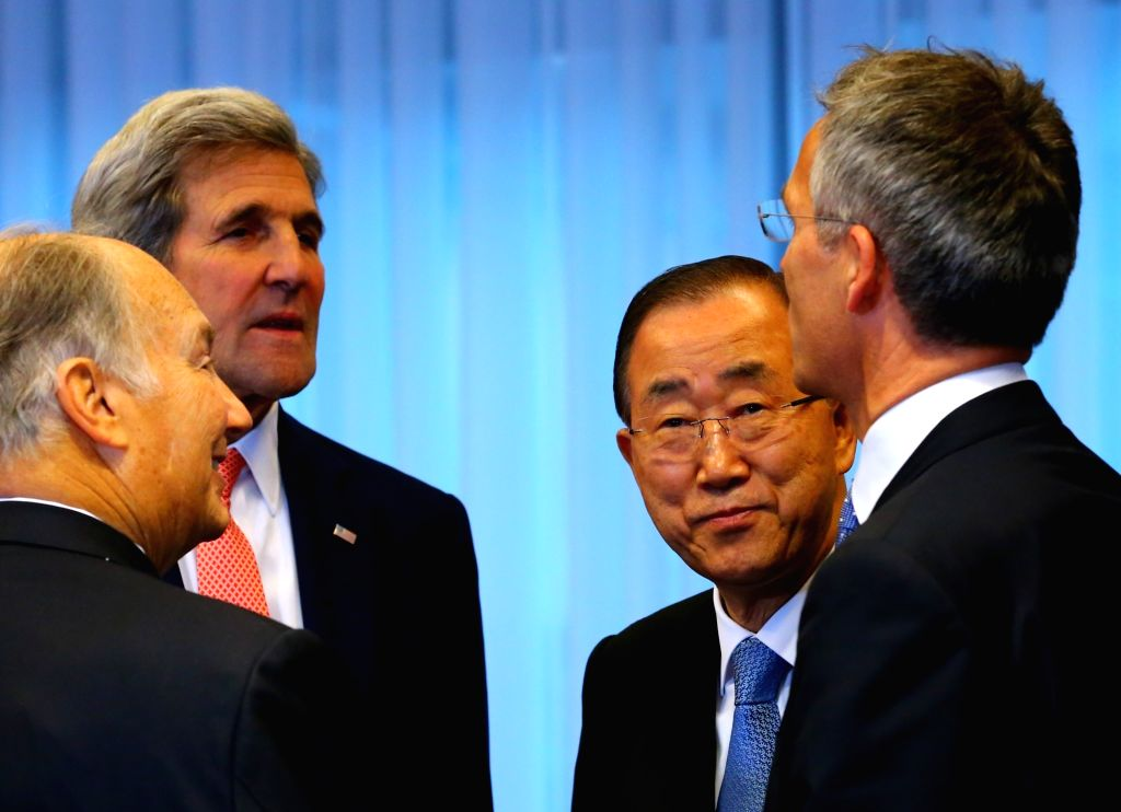 BRUSSELS, Oct. 5, 2016 - U.S. Secretary of State John Kerry (2nd L) speaks with United Nations Secretary-General Ban Ki-moon (2nd R) and delegates during the Brussels Conference on Afghanistan in ...