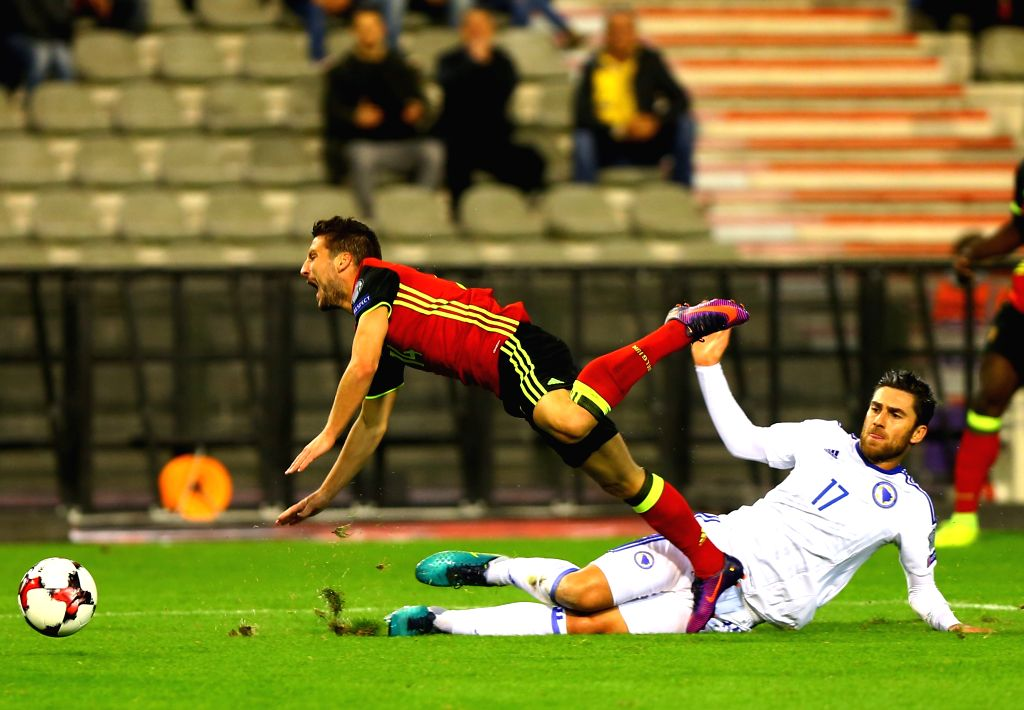 BRUSSELS, Oct. 8, 2016 - Belgium's Dries Mertens (L) vies with Bosnia and Herzegovina's Ervin Zukanovic during their FIFA World Cup 2018 football qualification match in Brussels, Belgium, on Oct. 7, ...