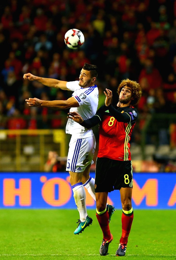BRUSSELS, Oct. 8, 2016 - Belgium's Marouane Fellaini (R) vies with Bosnia and Herzegovina's Sead Kolasinac during their FIFA World Cup 2018 football qualification match in Brussels, Belgium, on Oct. ...