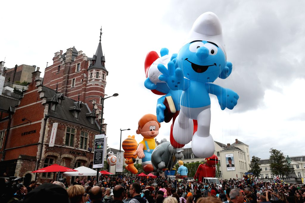 BRUSSELS, Sept. 15, 2018 - People attend the Balloon's Day Parade of the 2018 Brussels Comic Strip Festival in the center of Brussels, Belgium, Sept. 15, 2018. The Balloon's Day Parade is a ...