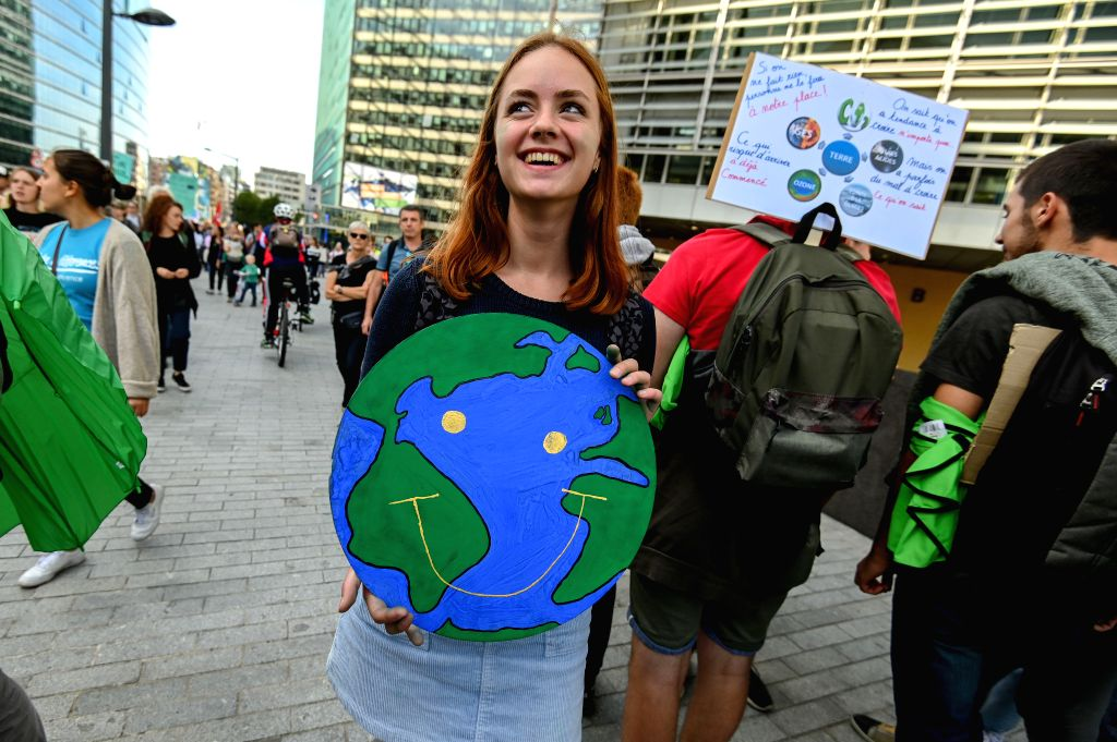 BRUSSELS, Sept. 20, 2019 - A girl holds a placard during a march calling for action against climate change in Brussels, Belgium, Sept. 20, 2019.