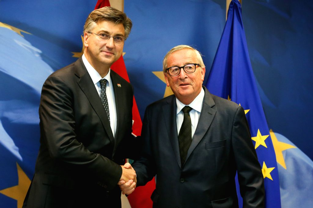 BRUSSELS, Sept. 27, 2019 - European Commission President Jean-Claude Juncker (R) shakes hands with Croatian Prime Minister Andrej Plenkovic at the European Commission headquarters in Brussels, ... - Andrej Plenkovic
