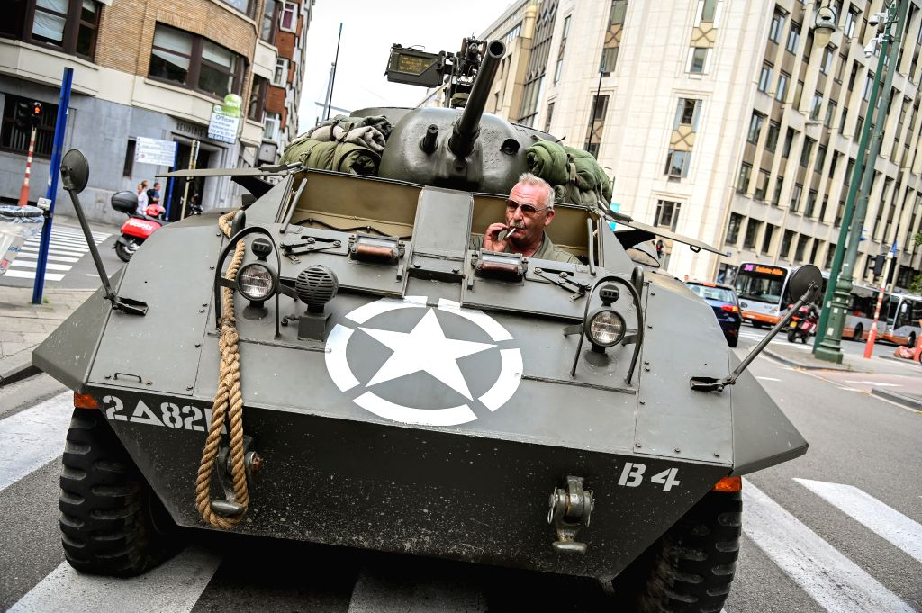BRUSSELS, Sept. 3, 2019 - A participant in a military vehicle takes part in a parade in commemoration of the 75th anniversary of the liberation of Brussels in Brussels, Belgium, Sept. 3, 2019. The ...