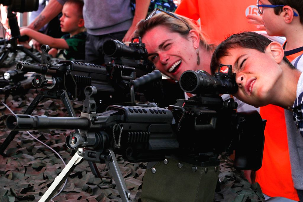 BRUSSELS, Sept. 4, 2019 - People look through the scopes of guns during the liberation celebration in Brussels, Belgium, on Sept. 4, 2019. Brussels held various celebrations to mark the 75th ...