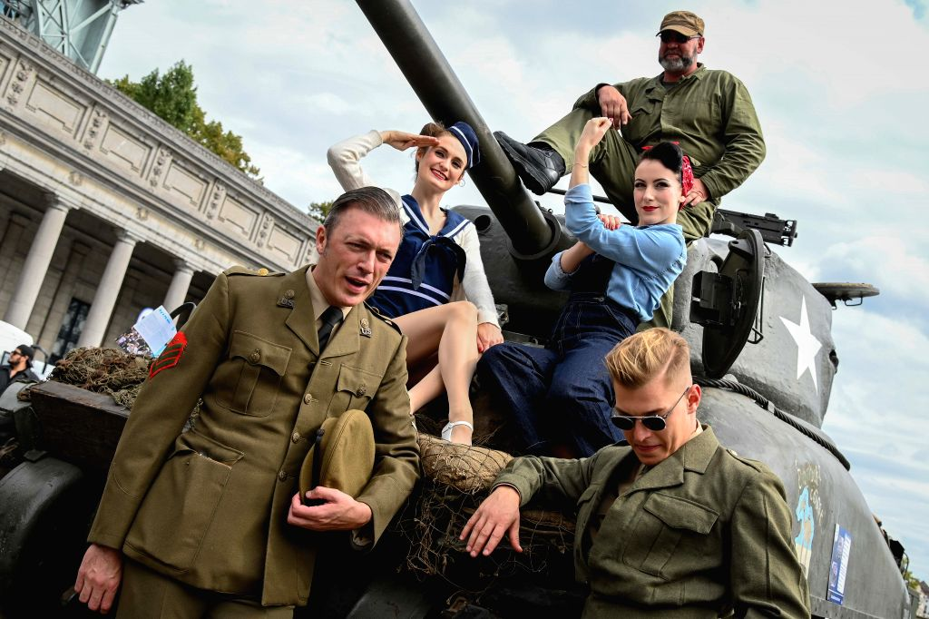 BRUSSELS, Sept. 4, 2019 - People pose for photos during the liberation celebration in Brussels, Belgium, on Sept. 4, 2019. Brussels held various celebrations to mark the 75th anniversary of the ...