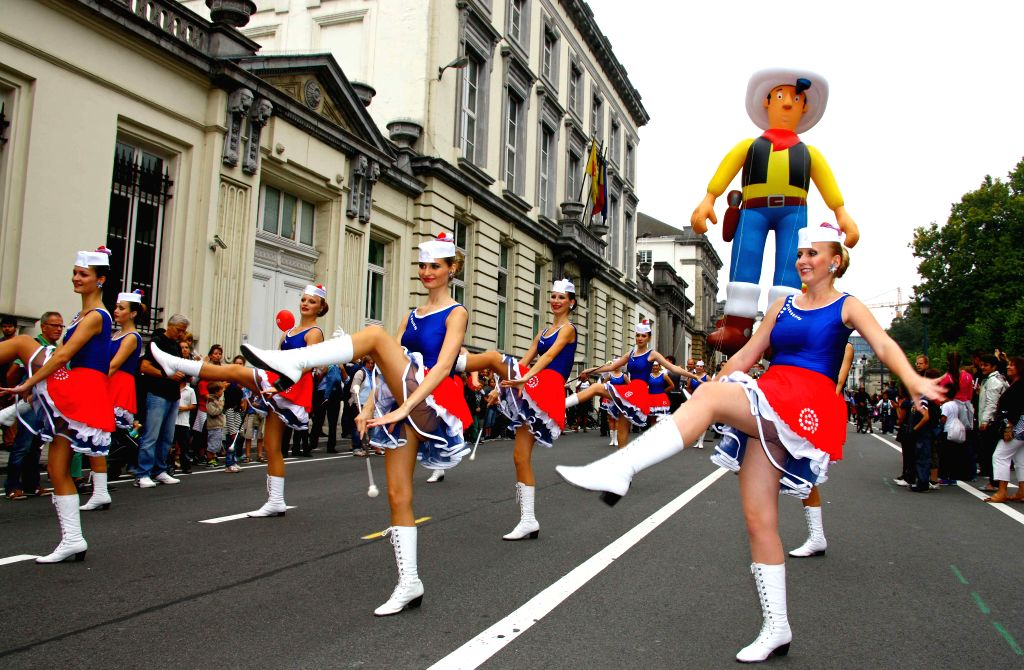 Girls parade during the Balloon's Day Parade as part of the annual Comic Book Festival in Brussels, capital of Belgium, on Sept. 6, 2014.
